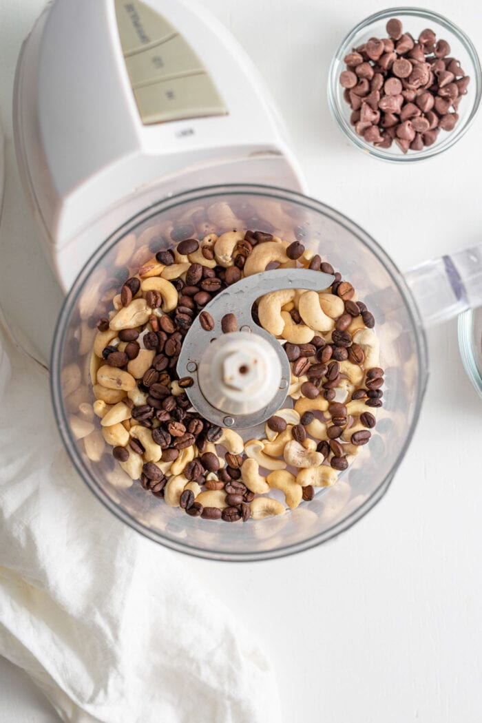 Raw cashews and coffee beans in a food processor.