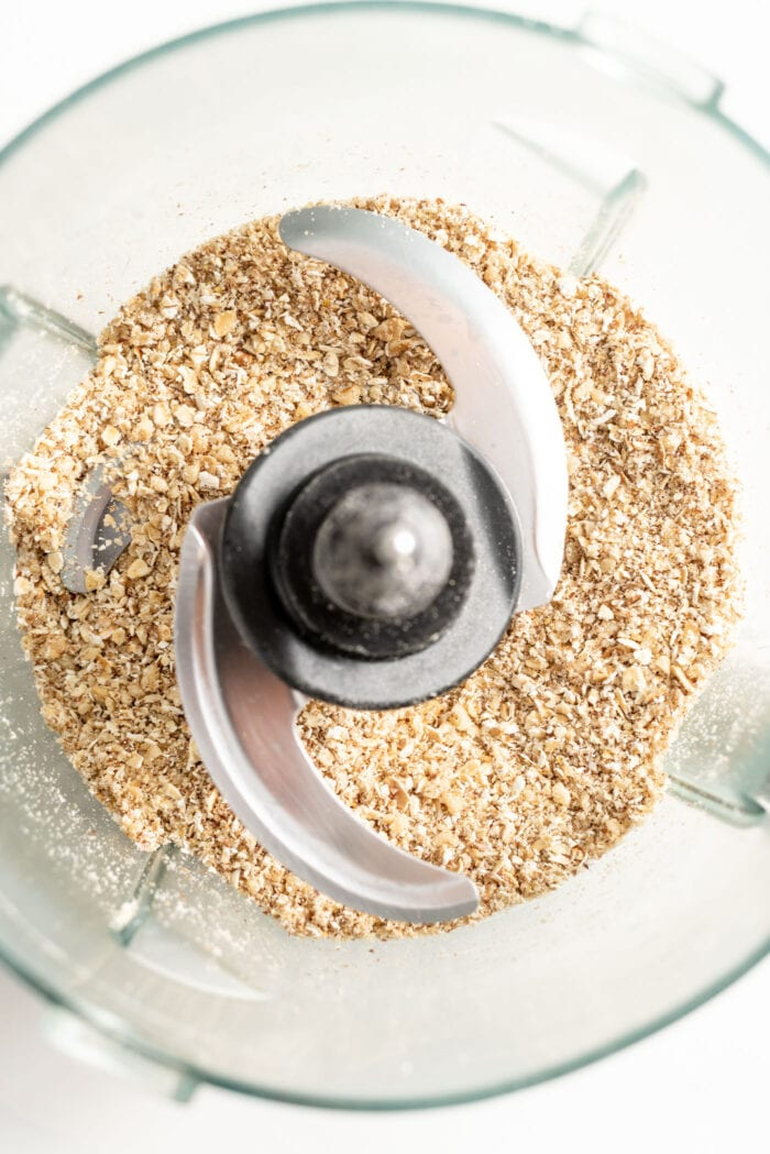 Oats and walnuts blended into flour in a food proccessor.