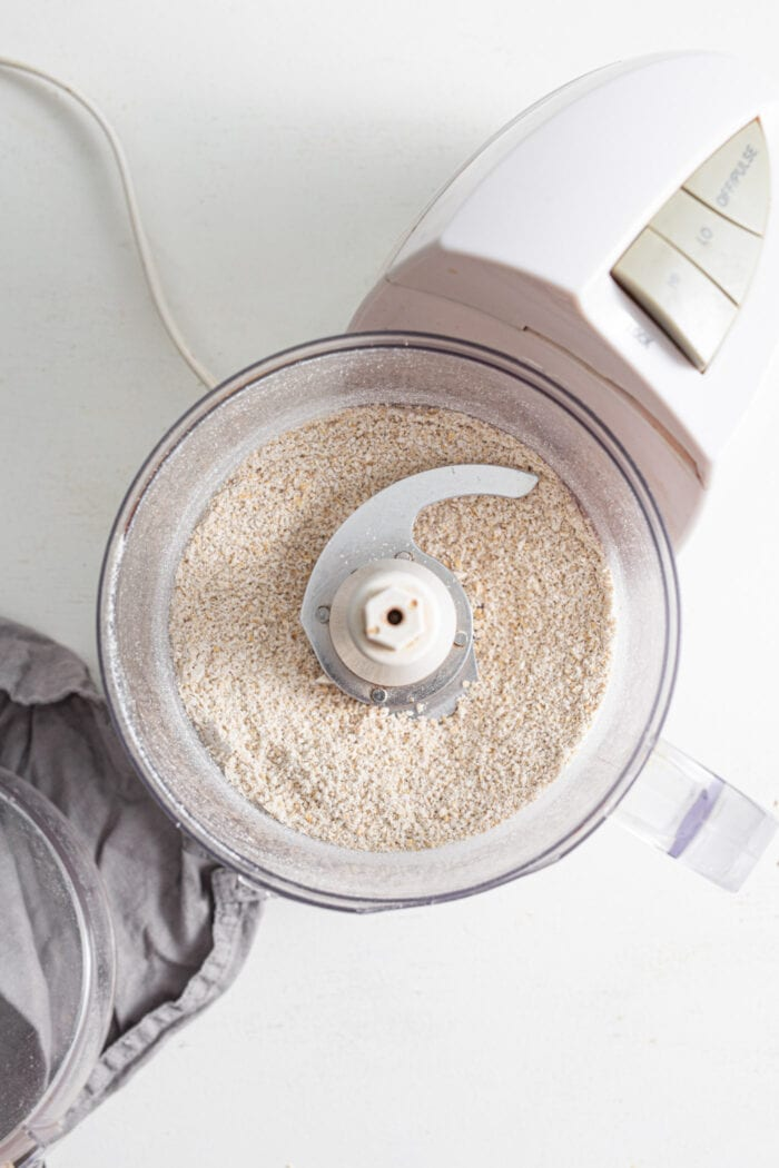 Oats blended into flour in a food processor.