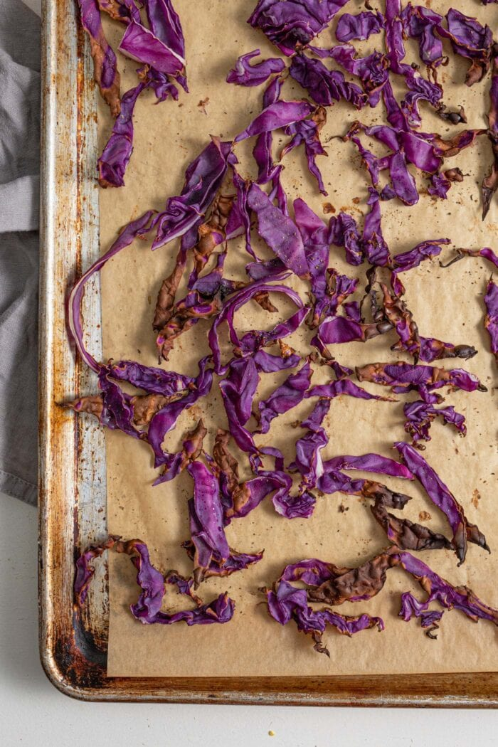 Roasted red cabbage on a baking tray.