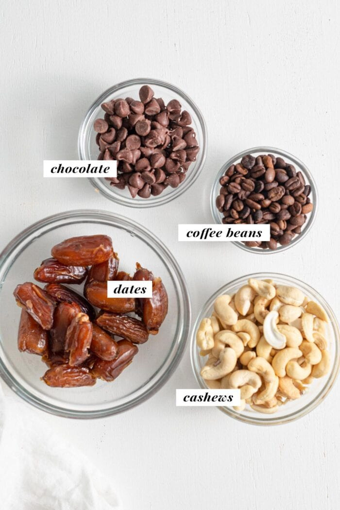Cashews, chocolate chips, dates and coffee beans in bowls. Each is labelled with text overlay.