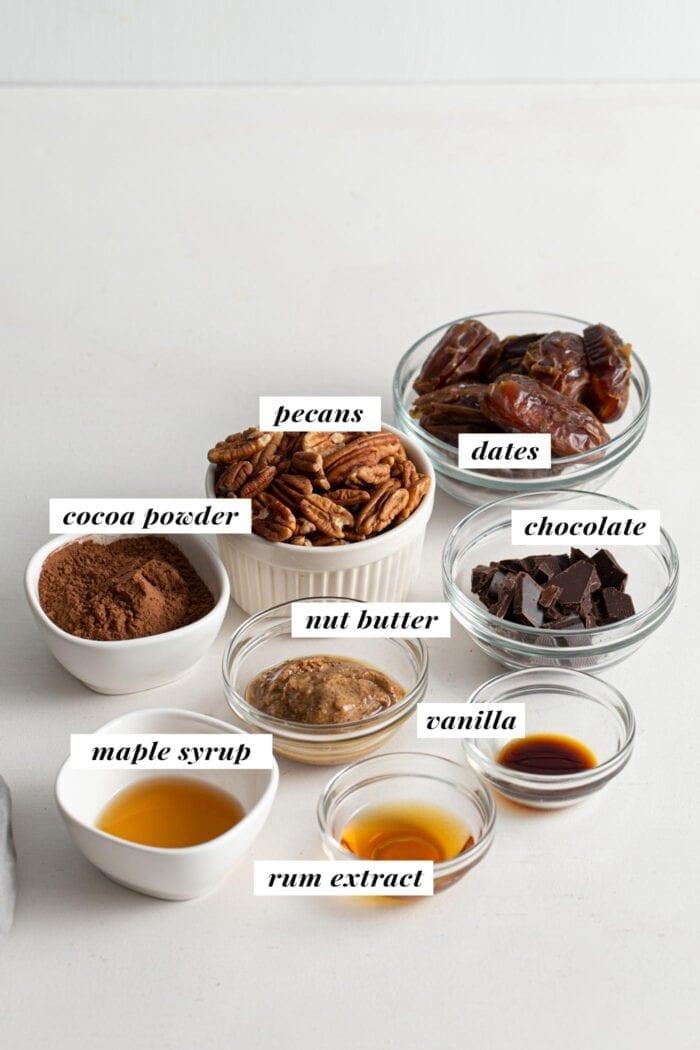 Visual of ingredient list for healthy vegan rum balls recipe.