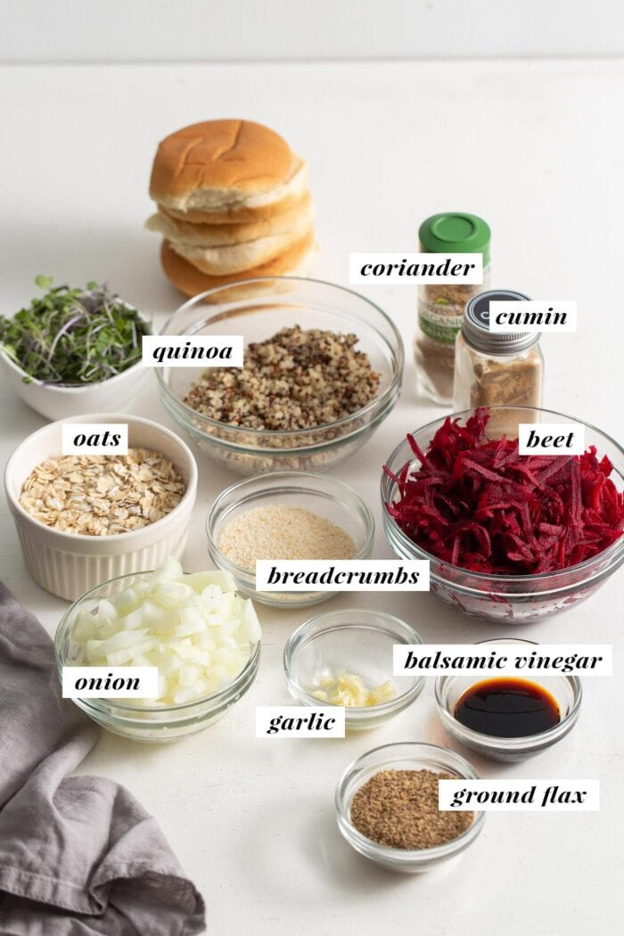 All ingredients for making quinoa beet burgers in bowls, labelled with text overlay.