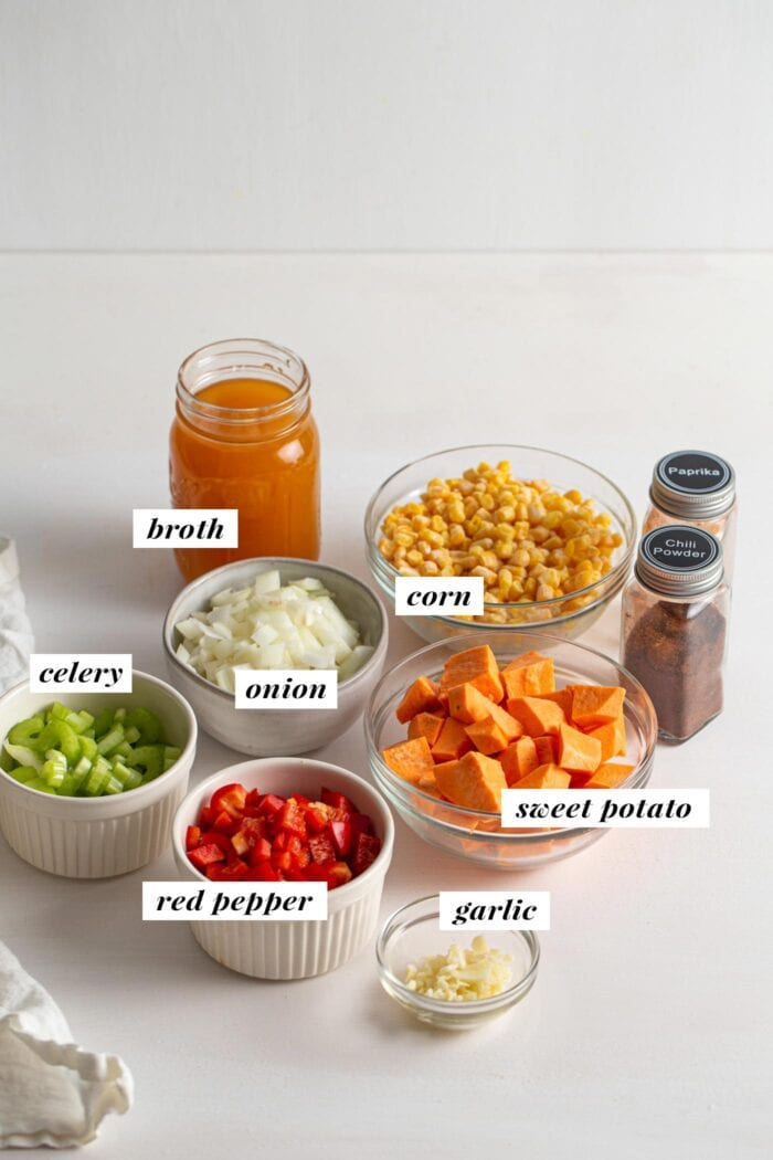 Visual of all ingredients needed for a sweet potato corn chowder recipe labelled with text overall.