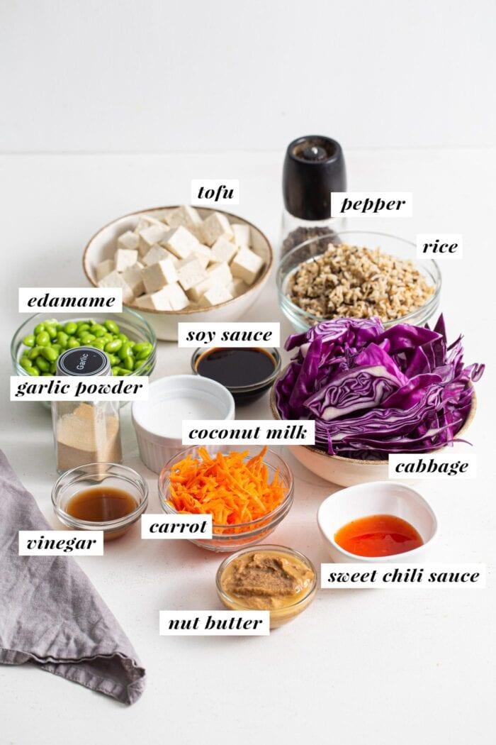 Labelled ingredients for making a tofu edamame buddha bowl.