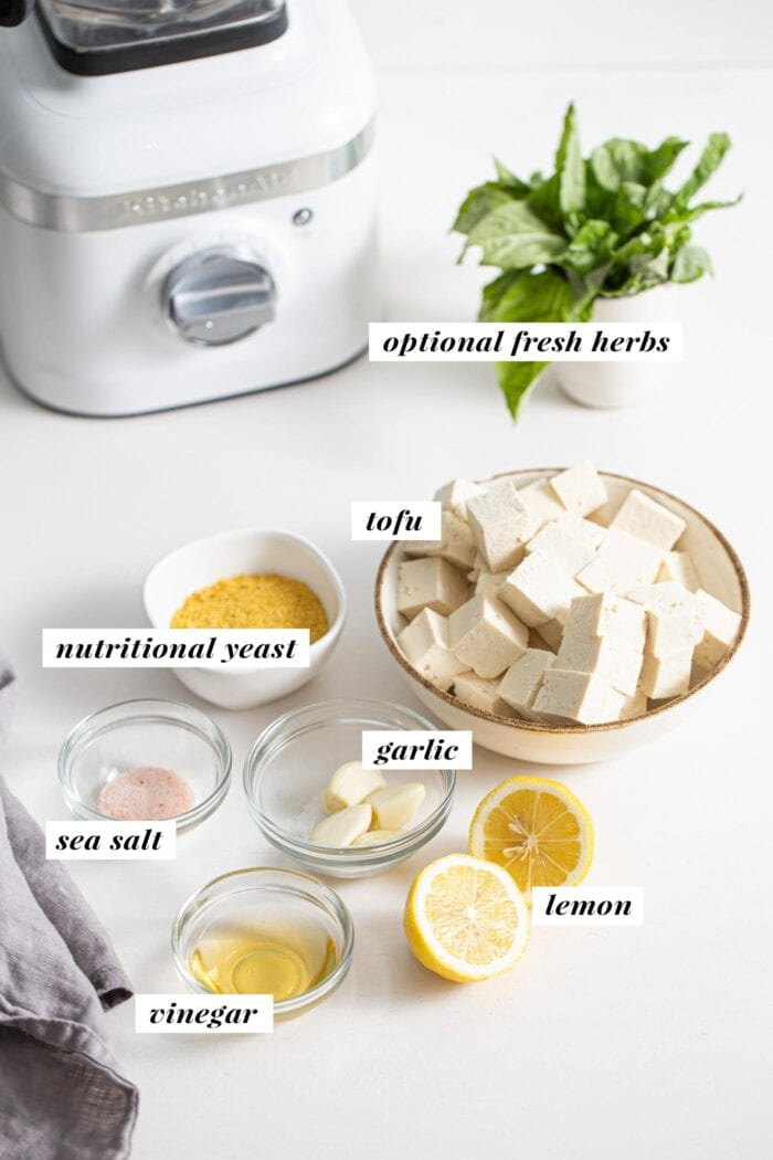 Various ingredients for making tofu ricotta in small dishes, labelled with text overlay.