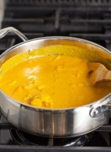 Creamy sweet potato soup in a pot on the stovetop.