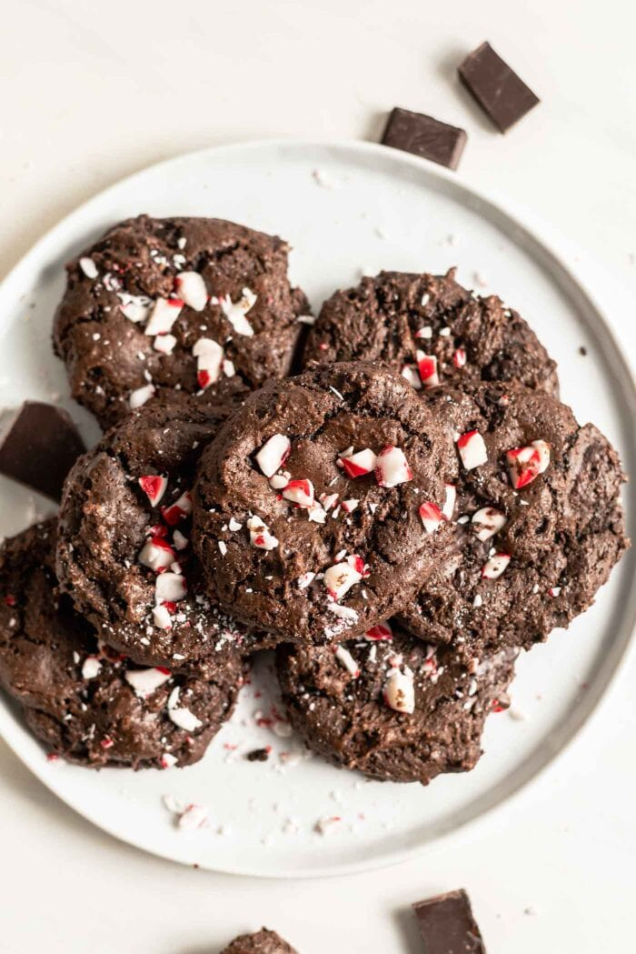 Plate of chocolate peppermint cookies topped with crushed candy canes.