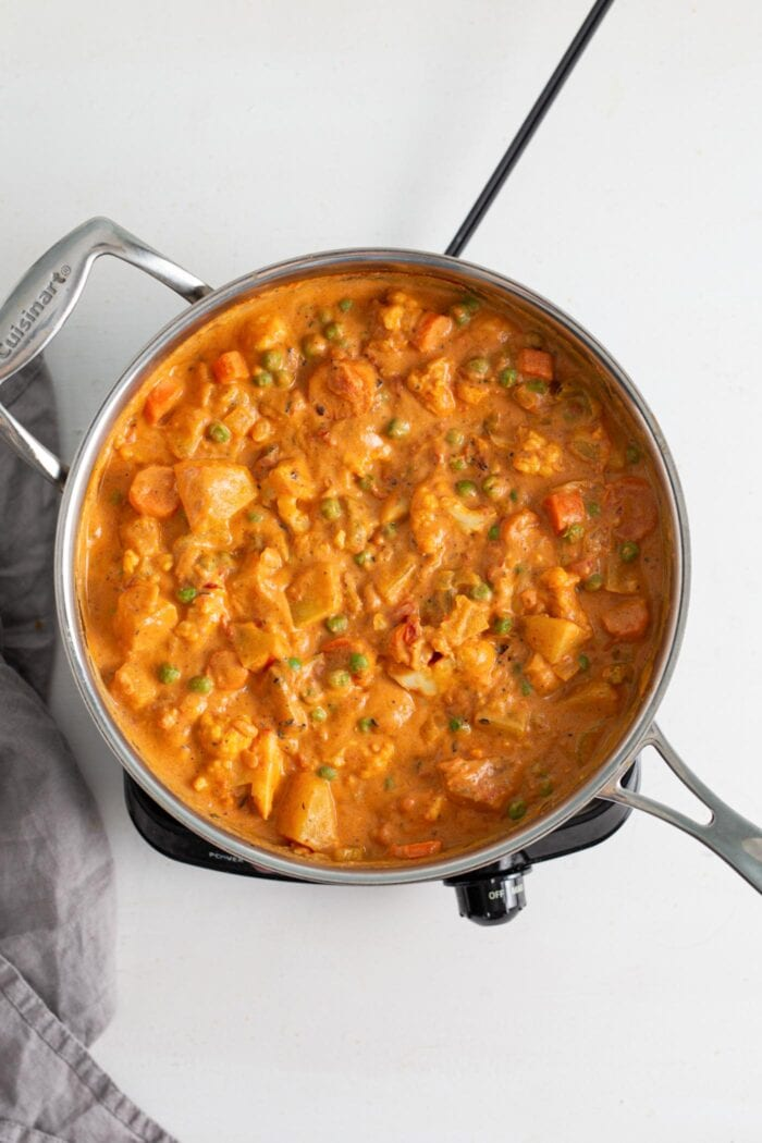 Overhead view of vegetable korma in a skillet.