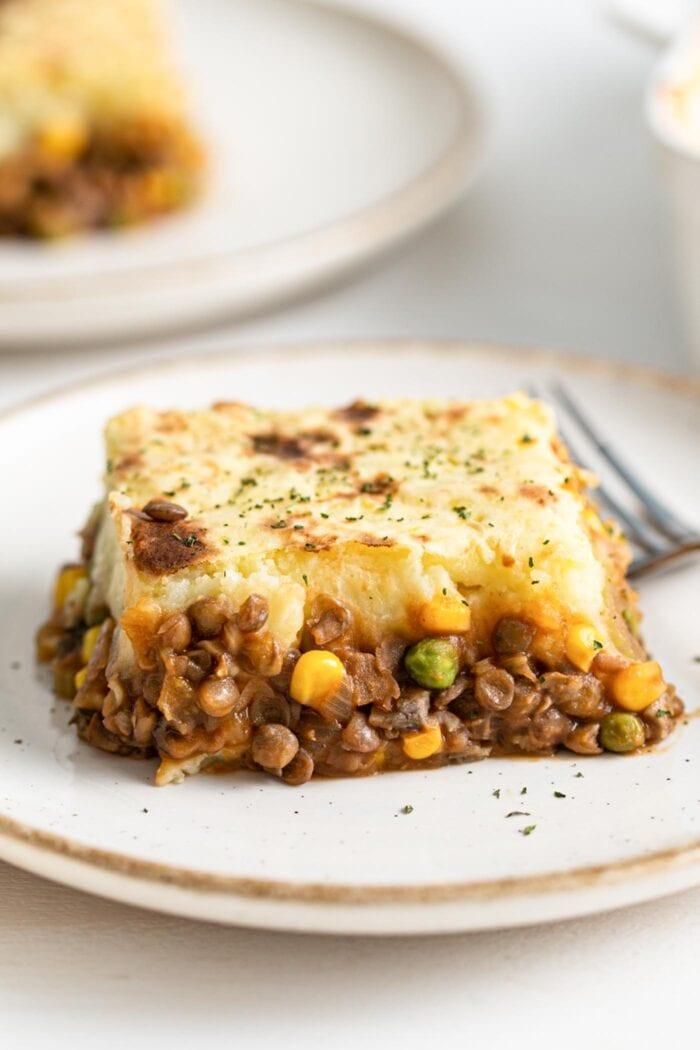 Large slice of lentil shepherd's pie on a plate.