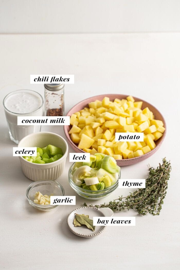 Visual of ingredients for a vegan potato and leek soup recipe. Each ingredient is labelled with text overlay.