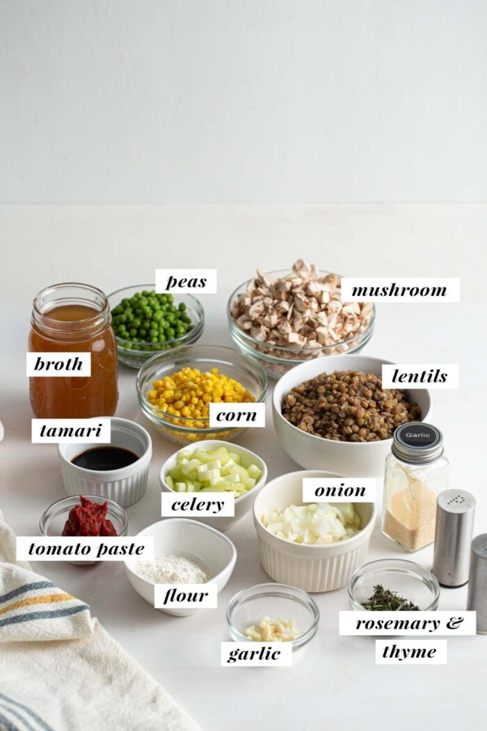 Visual list of ingredients for making lentil shepherds pie. Each ingredient labelled with text overlay.