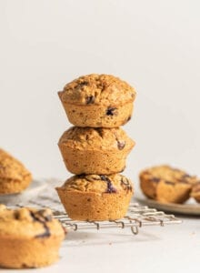 Stack of 3 muffins on a cooling rack.