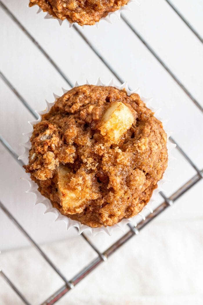 Overhead view of an apple muffin topped with brown sugar.