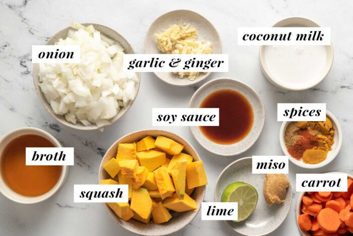 Visual list of ingredients for making a kabocha squash and carrot curried soup.