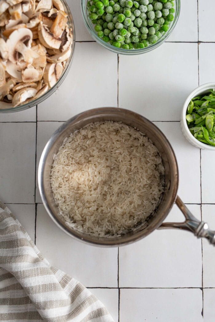 Cooked basmati rice in a small pot.