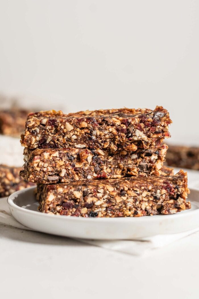 Stack of 3 chocolate energy bars on a plate.