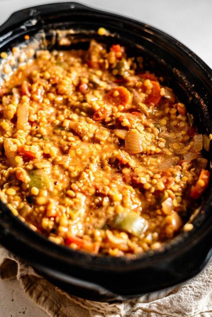 Red lentil chili in a slow cooker.