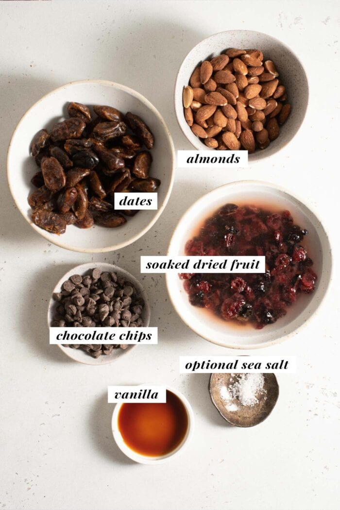 Visual of ingredients needed for making no-bake almond cherry energy bars.