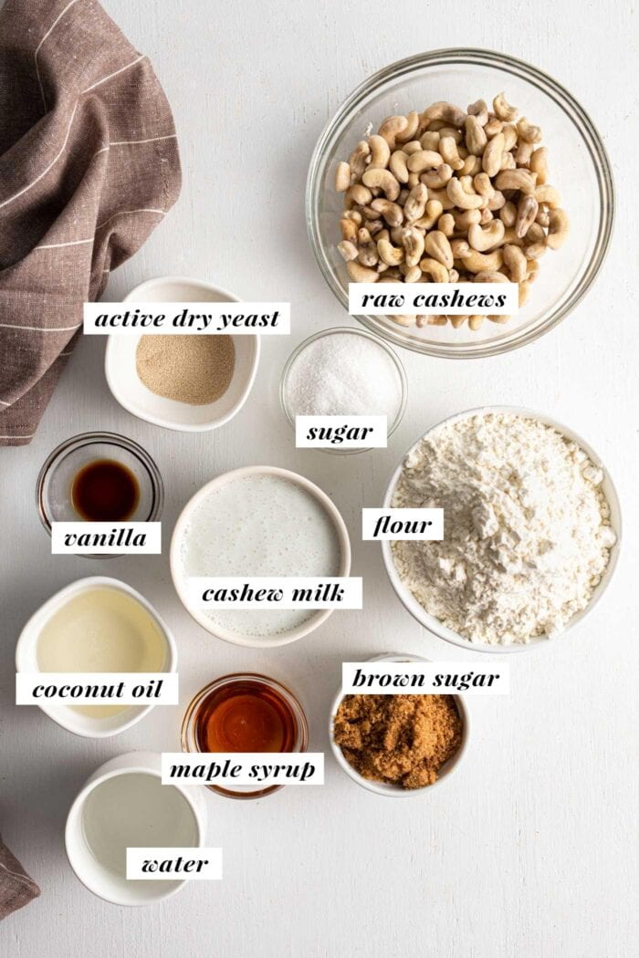 Visual of all ingredients needed for making cinnamon rolls labelled with text overlay.