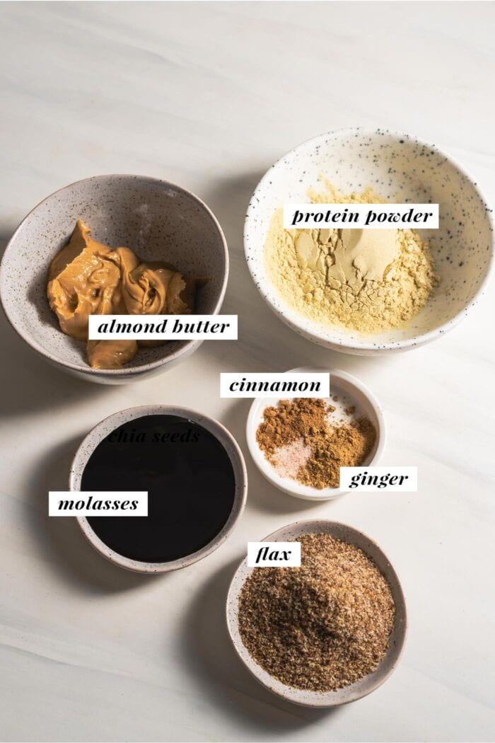 Visual list of ingredients needed for making gingerbread protein balls.