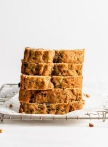 Stack of 5 thick slices of zucchini bread.