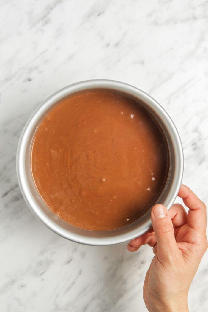 Raw chocolate cake in a springform pan.