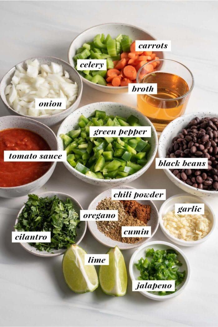 Visual of ingredients needed for making vegan black bean soup, each ingredient labelled with text overlay.