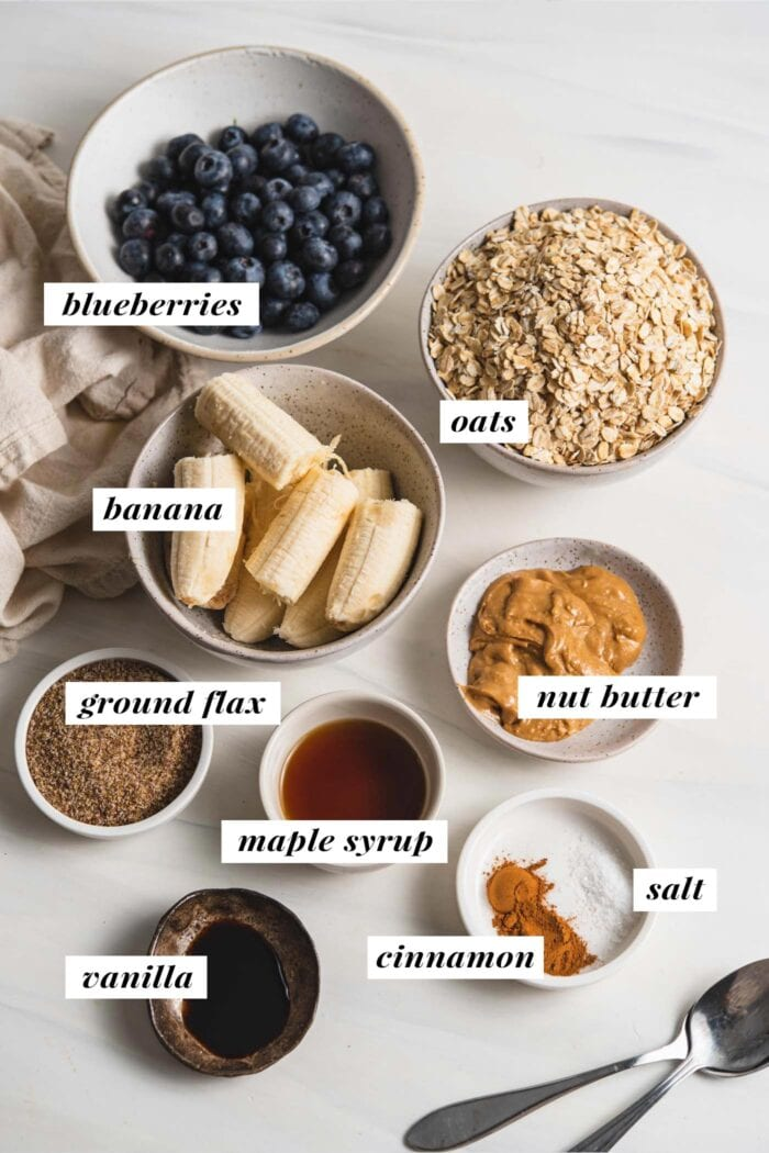 Visual of ingredients for blueberry baked oatmeal cups labelled with text overlay.