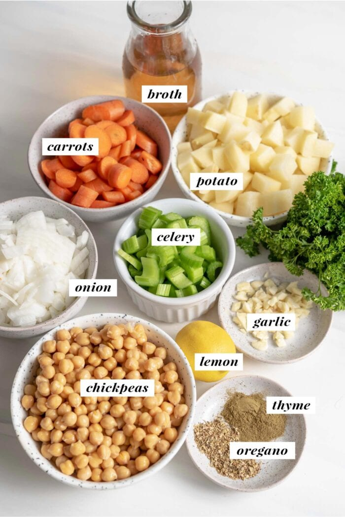 Visual of ingredients needed for making chickpea chowder soup recipe. Each ingredient is labelled with text.
