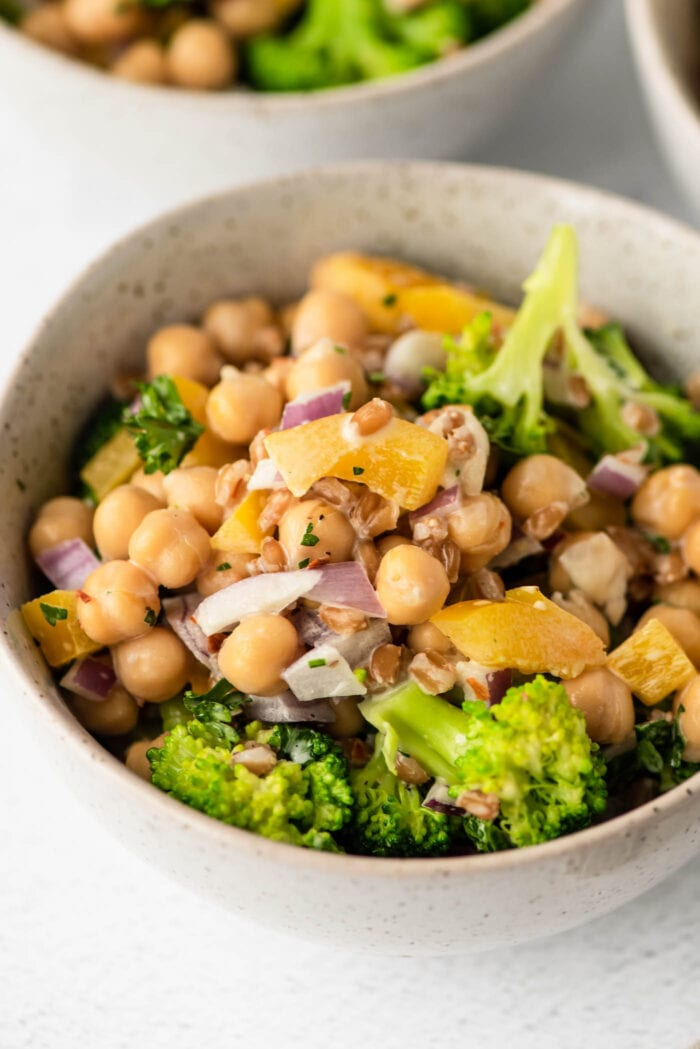 Close up of a broccoli chickpea salad with farro and red onion.