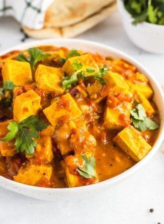 Bowl of tofu tikka masala topped with fresh cilantro.