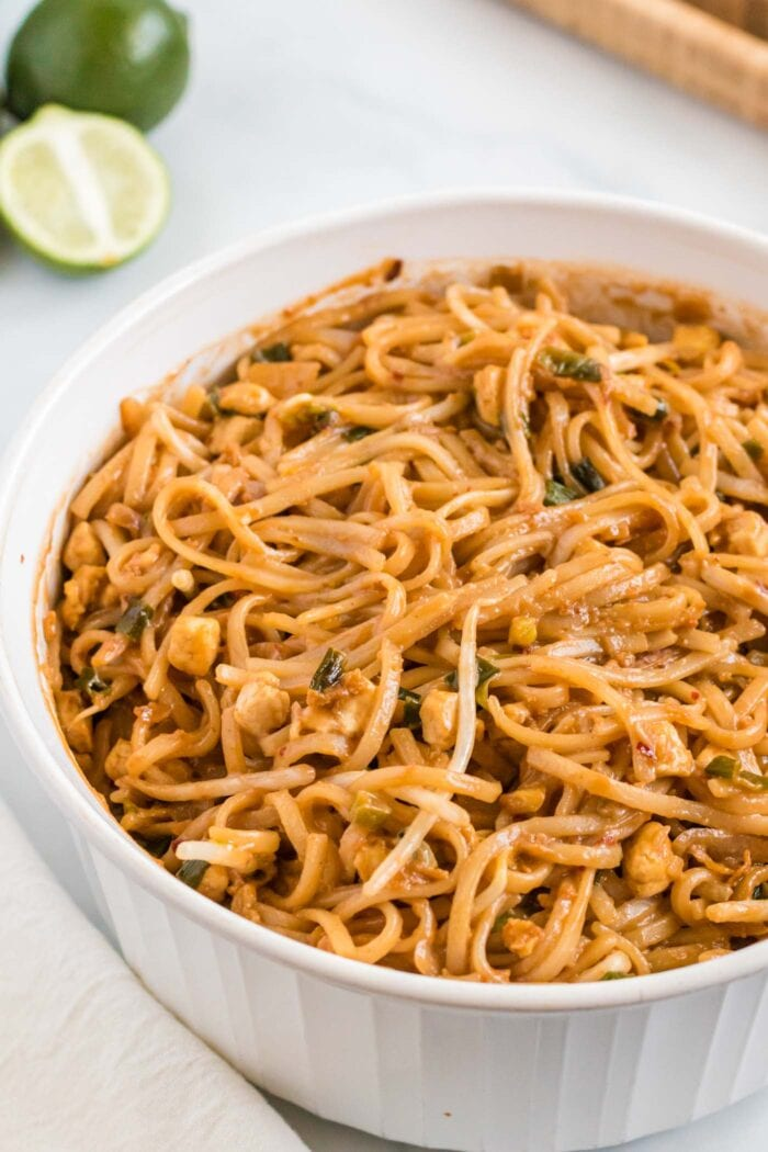 Close up of a large bowl of pad Thai noodles with tofu and bean sprouts.