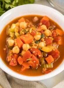 Bowl of tomato stew with chickpea sand quinoa.