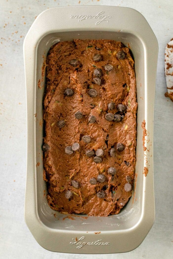 Raw chocolate zucchini bread batter in a loaf pan.