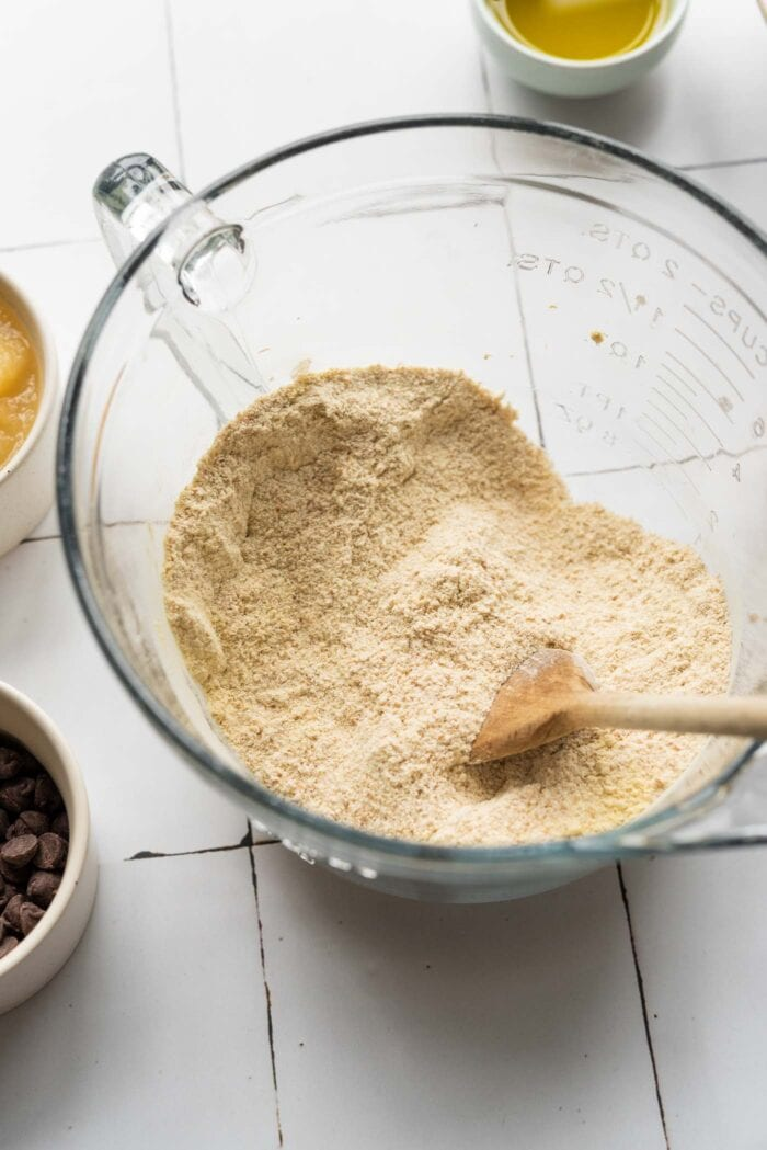 Flour and protein mixed together in a glass mixing bowl.