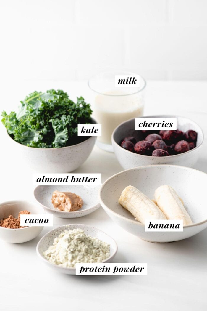 Visual list of ingredients for making a chocolate cherry smoothie. Each ingredient is labelled with text.