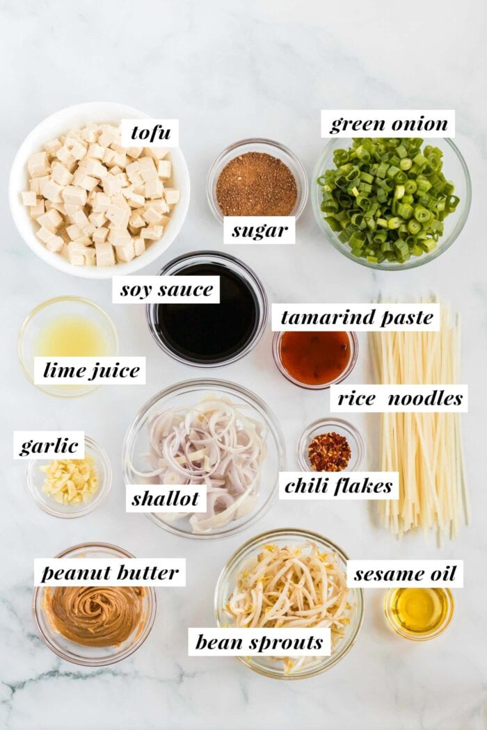 Visual list of ingredients for making a vegan tofu pad thai recipe. Each ingredient is labelled with text.
