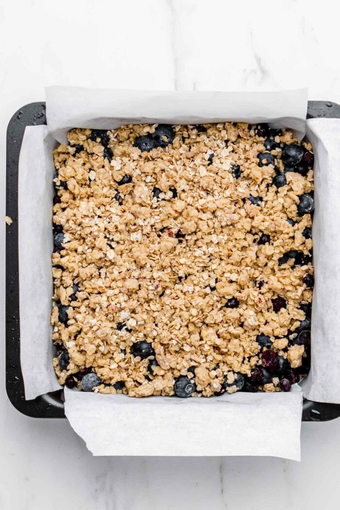 Blueberry crumble oat bars in a baking pan.