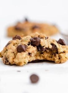 Chocolate chip zucchini cookie with a bite taken out of it.