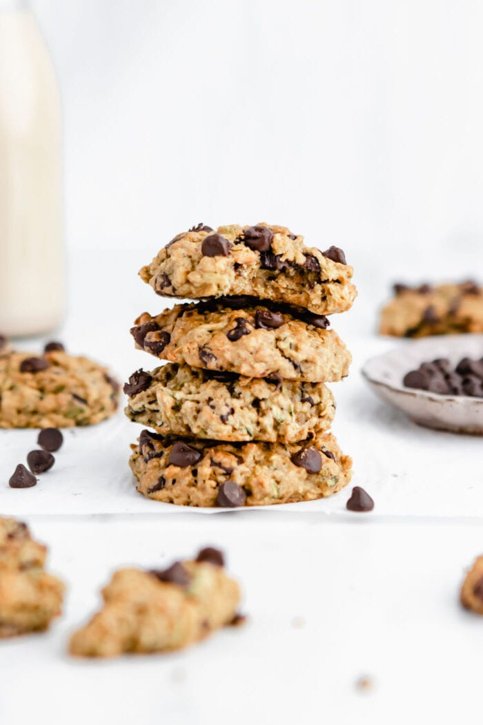 Stack of 4 chocolate chip zucchini cookies. One on the top has a bite out of it.