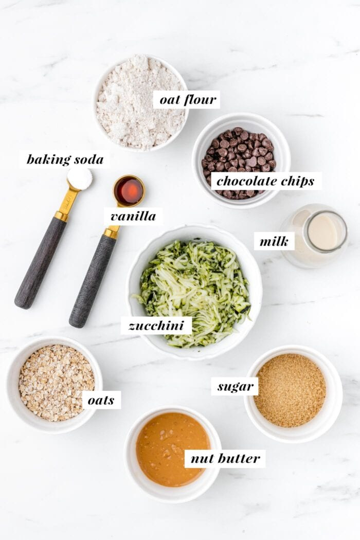 Visual list of ingredients for making chocolate chip zucchini cookies.