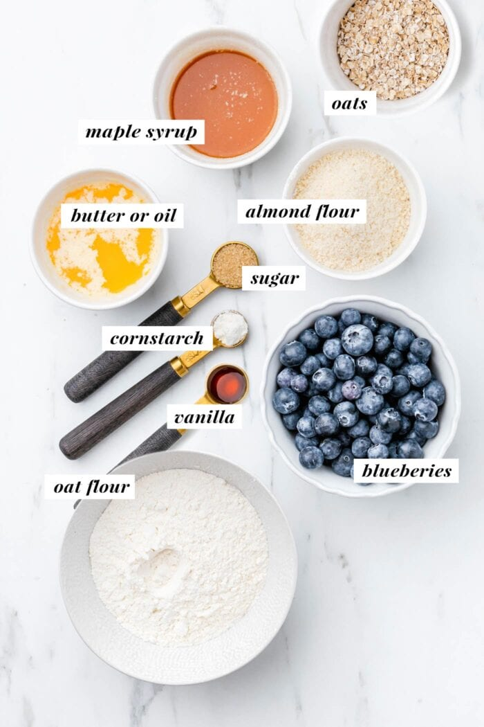 Visual of ingredients needed for making a vegan blueberry crumble bar recipe.