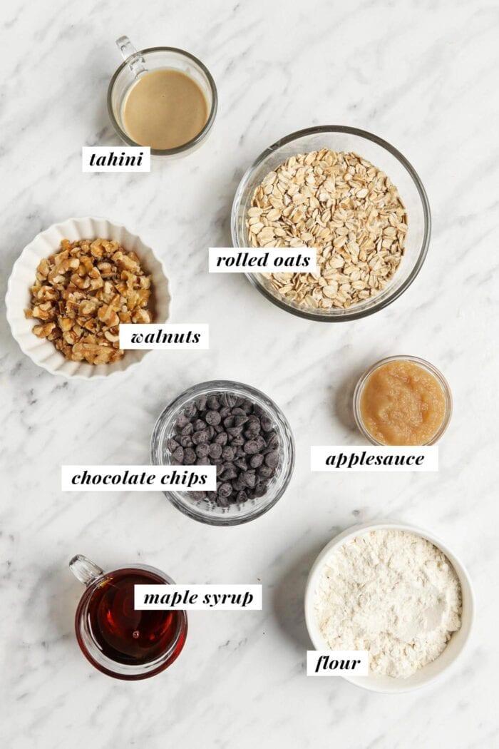 Visual list of ingredients for making tahini oatmeal breakfast cookies.