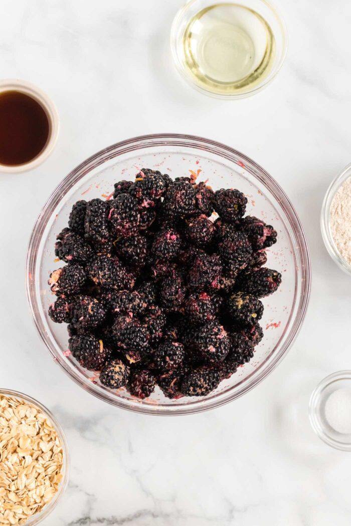 Blackberries mixed together in a mixing bowl.