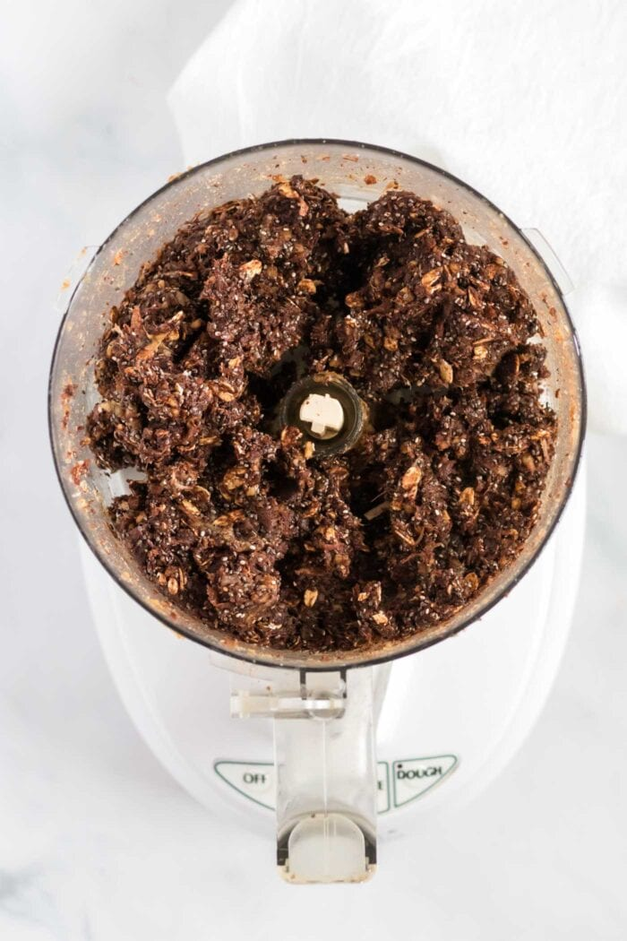 Thick chocolate dough in a food processor.