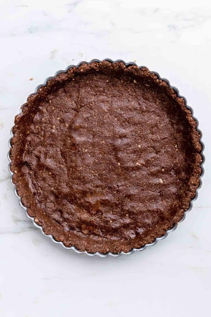 Chocolate pie crust pressed into a pie tin.