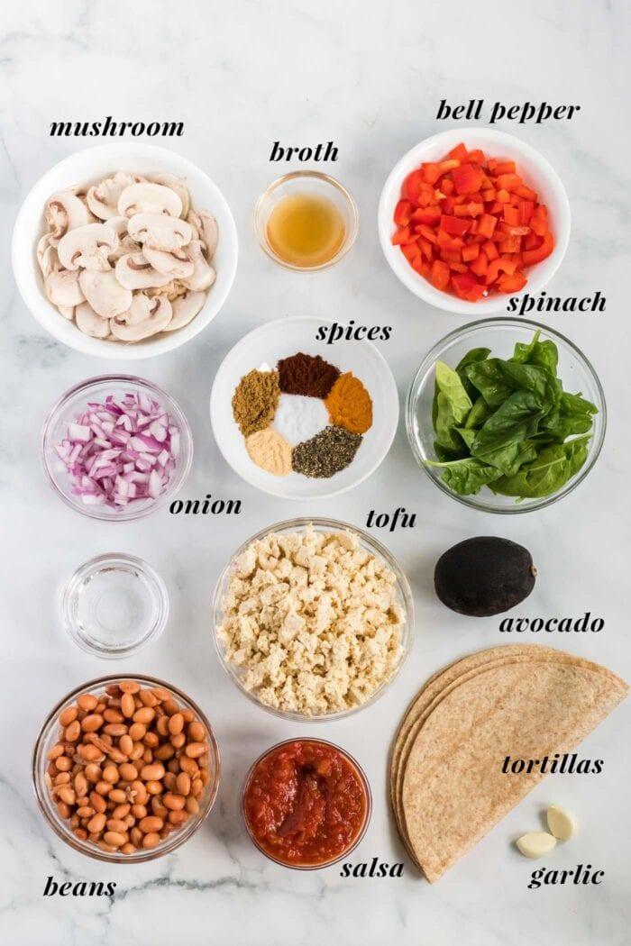 Visual list of ingredients for making a tofu scramble breakfast burrito.