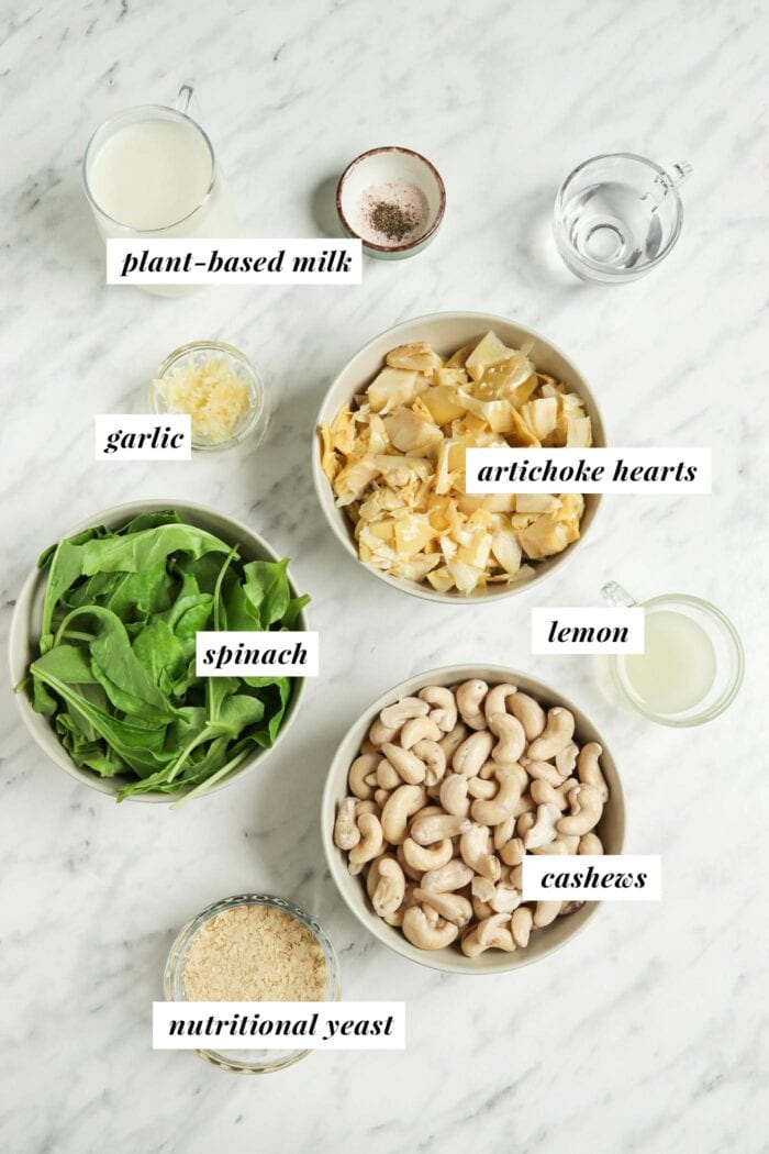 Visual list of ingredients for making spinach artichoke dip.