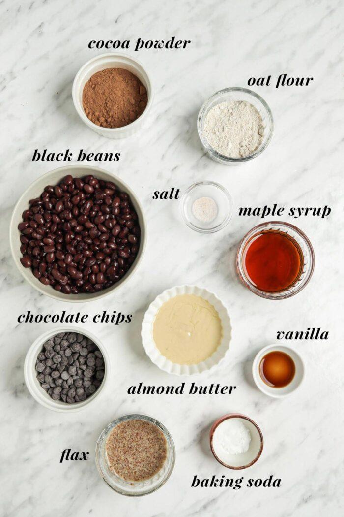 Visual ingredient list for making vegan black bean brownies.